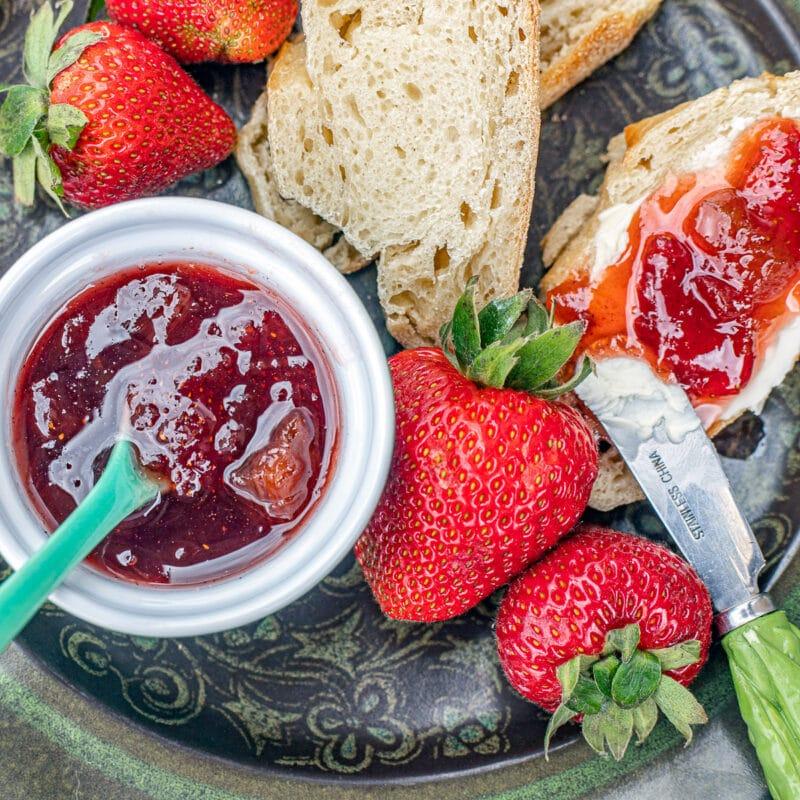 strawberry rhubarb preserves on toast with fresh strawberries