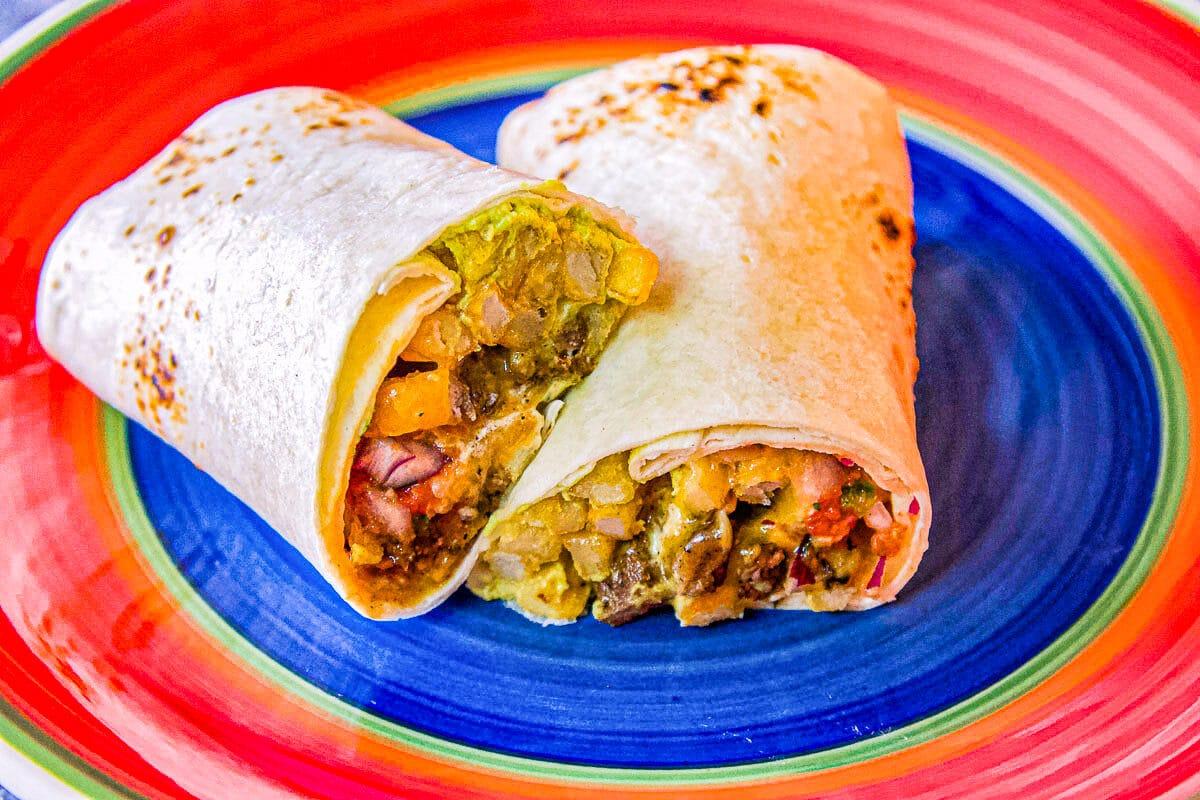 california burrito on a colorful plate