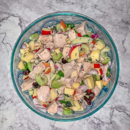 chopped chicken salad ingredients in a blue bowl