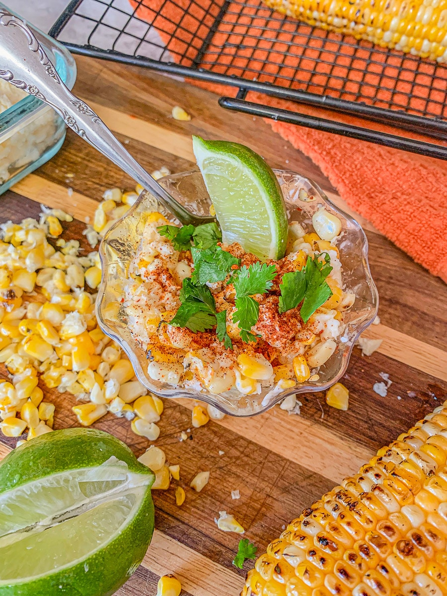 elote in a cup with fixings