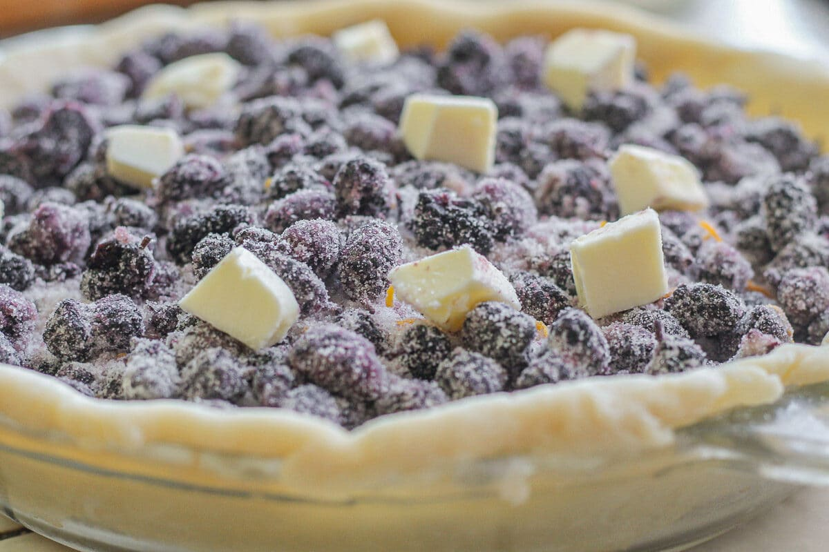 mulberries with butter cubes in a pie shell