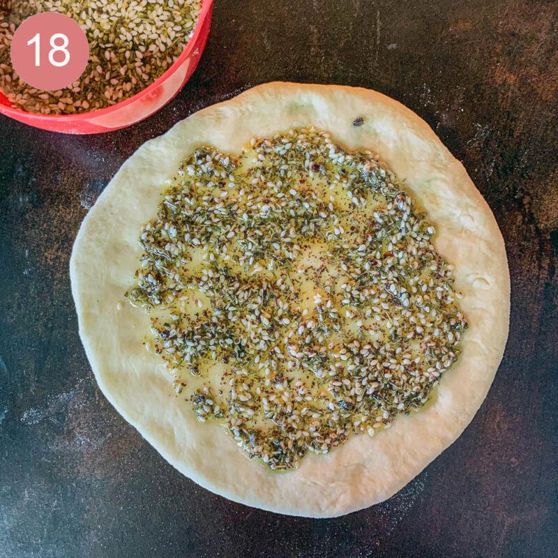 zaatar paste on raw flatbread dough for manaqish recipe