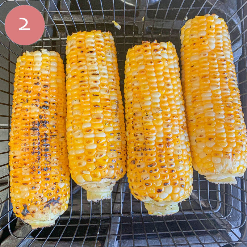 four corn on the cob on a basket