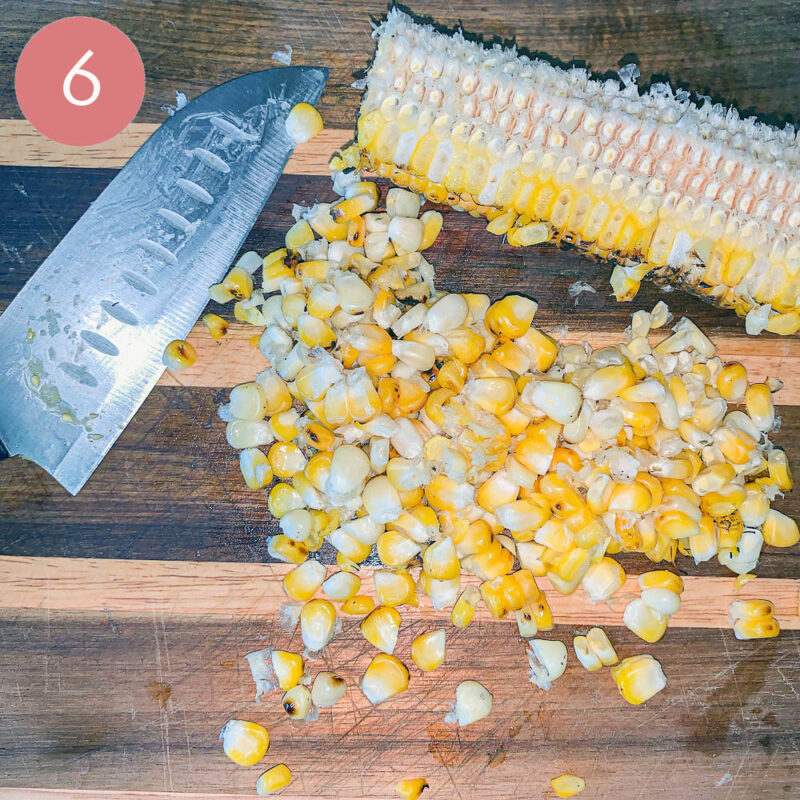 corn sliced off the cob on a cutting board