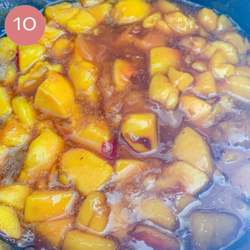 peach sauce being cooked in a pot