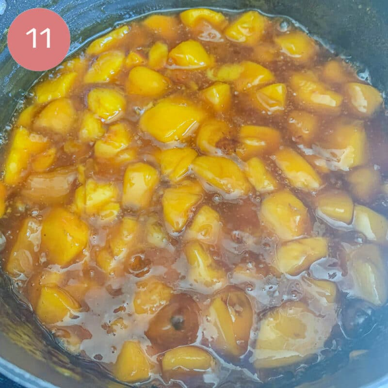 chopped peaches being cooked in a pot