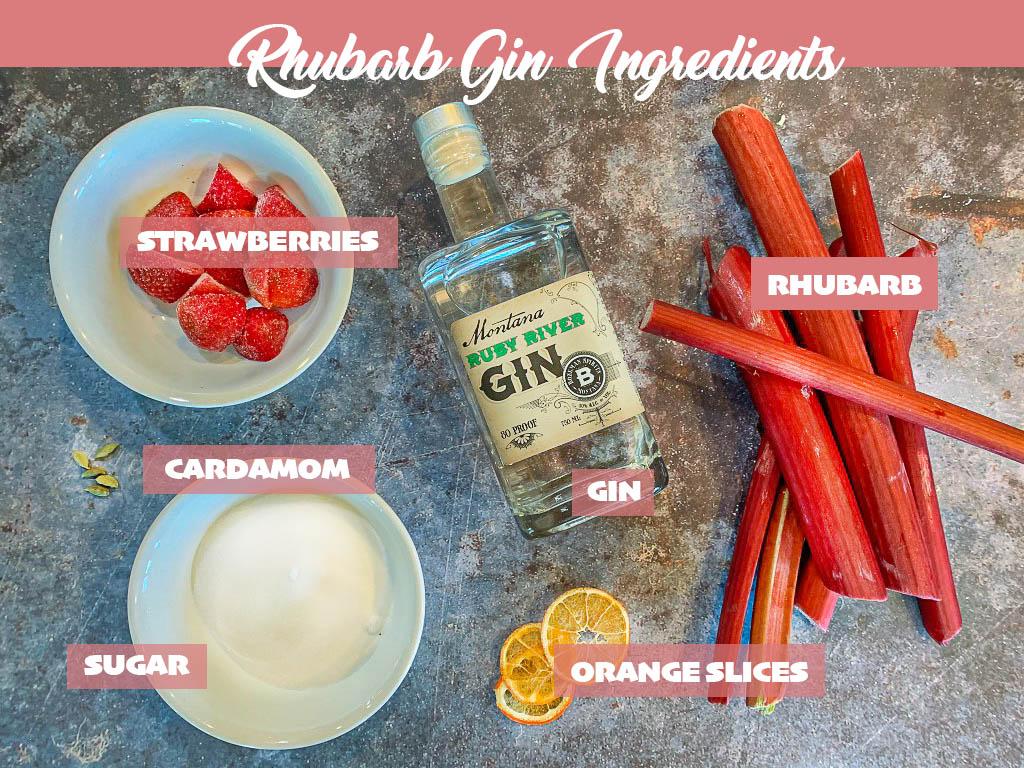 rhubarb gin ingredients including gin, rhubarb, strawberries, sugar, orange slices and cardamom