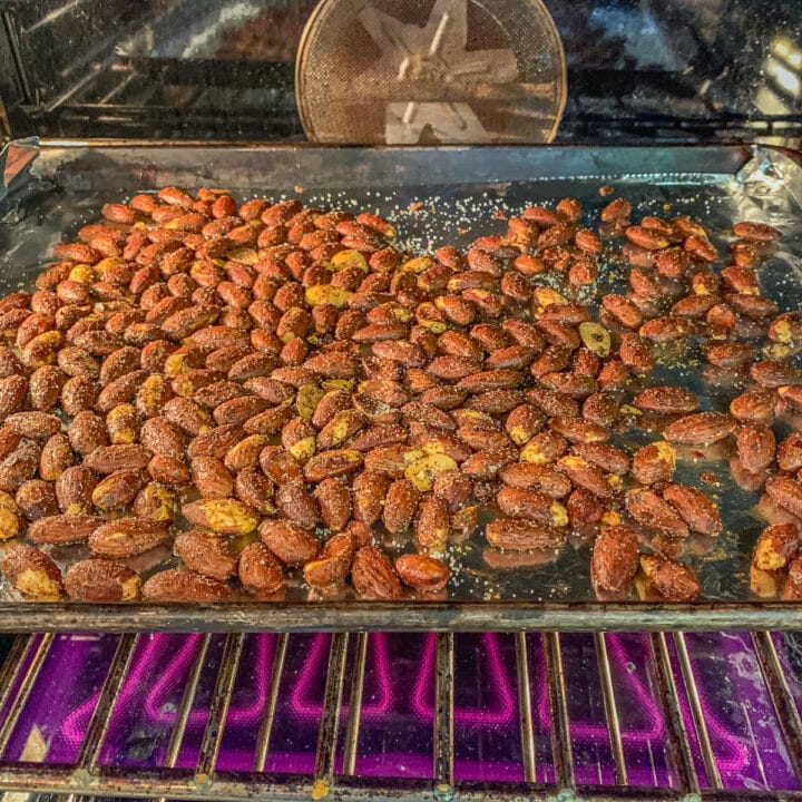almonds on a pan in the oven