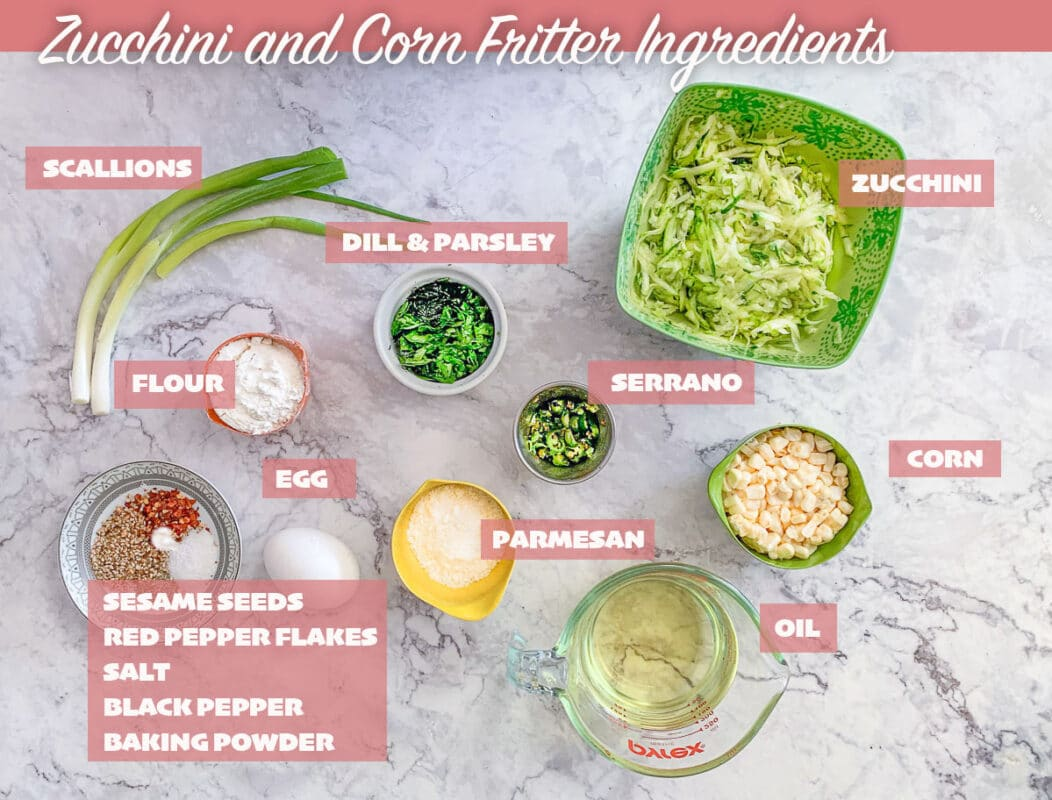 labeled zucchini and corn fritters ingredients on a marbled background