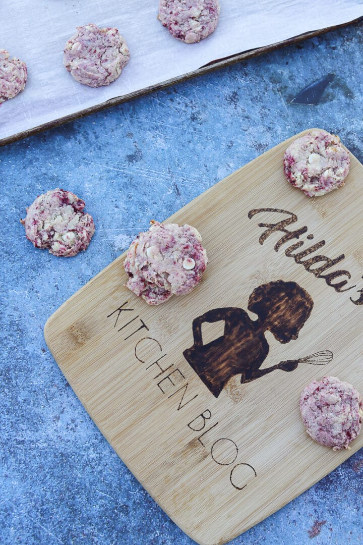 thimbleberry cookies on a cutting board and some on a cookie tray