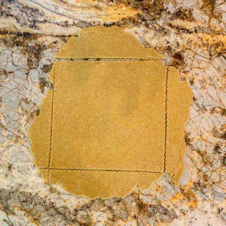 Chebakia cookie dough cut into a square