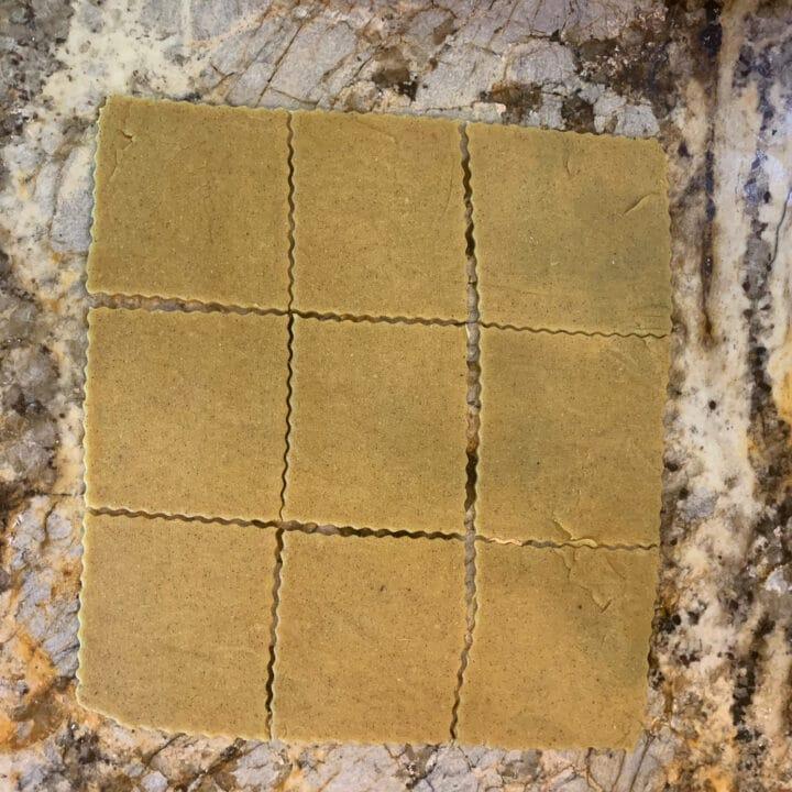 Chebakia cookie dough cut into 9 squares