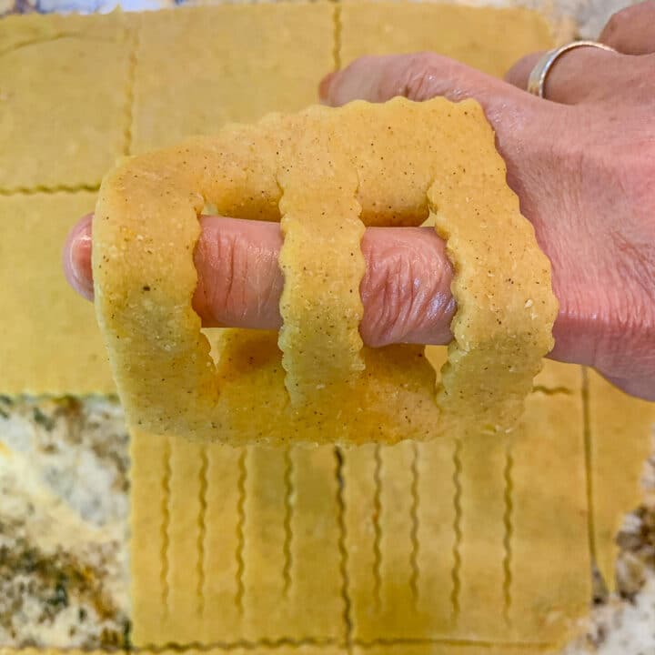 forming Chebakia cookie dough over a finger
