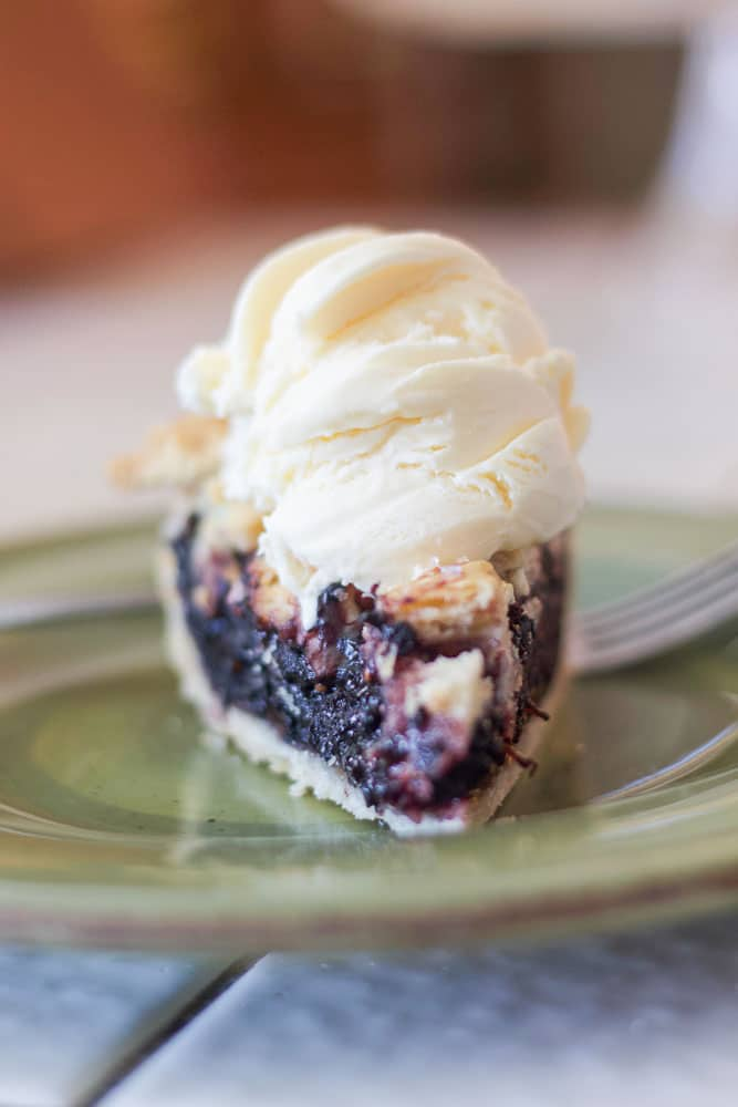 a slice of mulberry pie with ice cream
