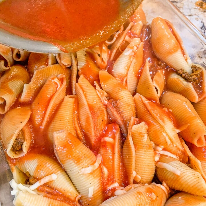 sauce being poured over shells