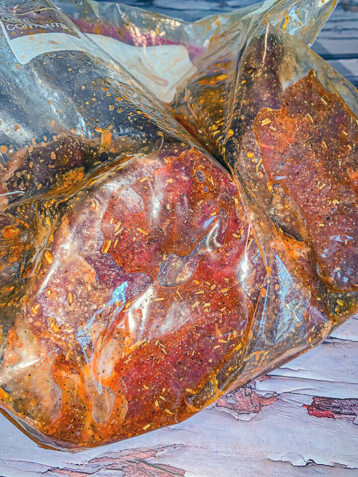 marinated steak in a ziplock bag