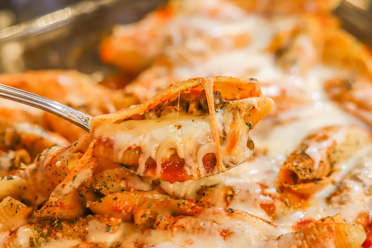 cheesy stuffed shells with meat being served