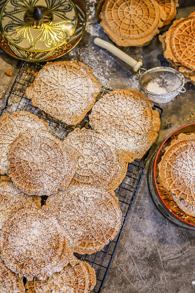 italian Pizzelle cookies on a cooling rack