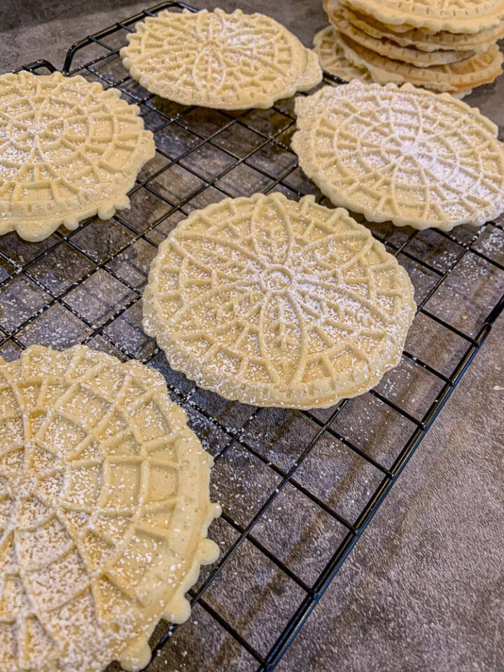 authentic Italian Pizzelle on a cooling rack