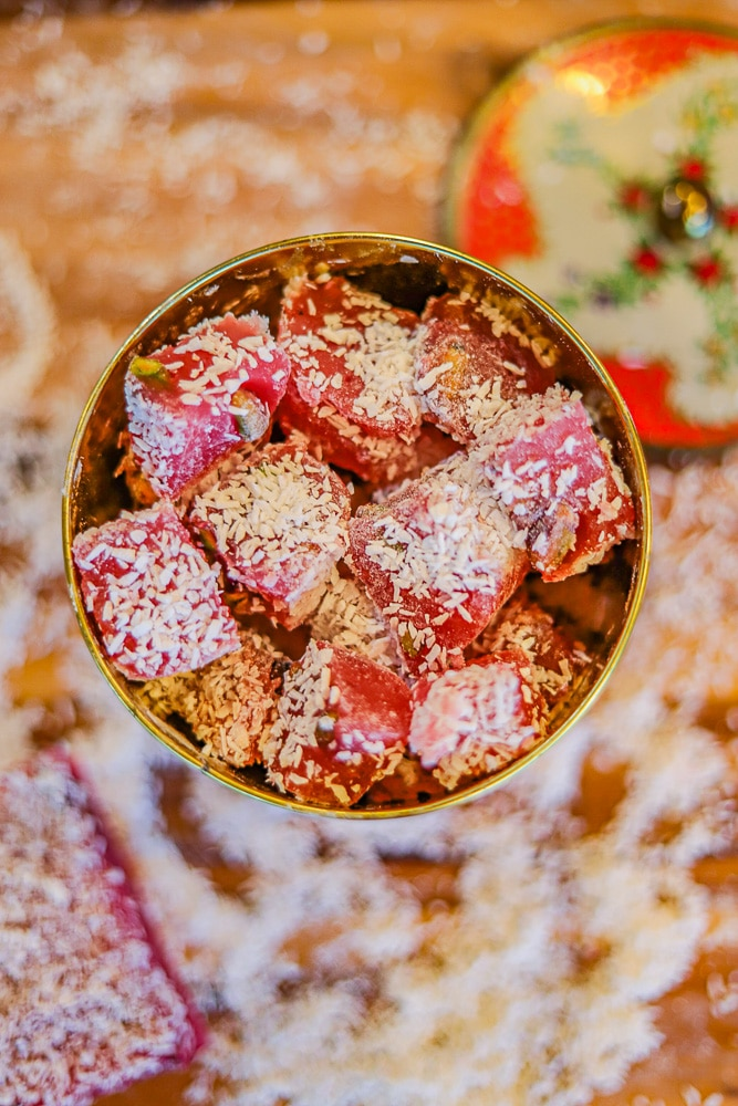 a round tin full of Turkish delight on a cutting board