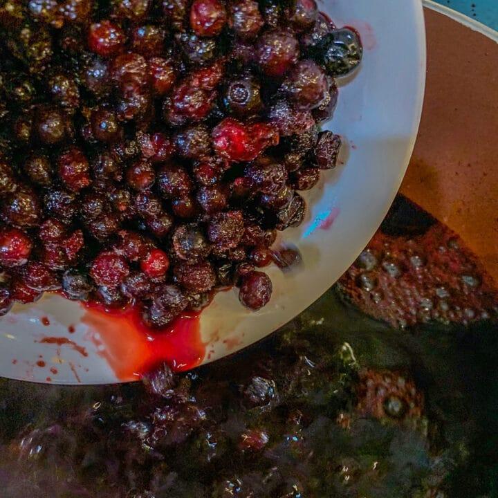 adding huckleberries to pot