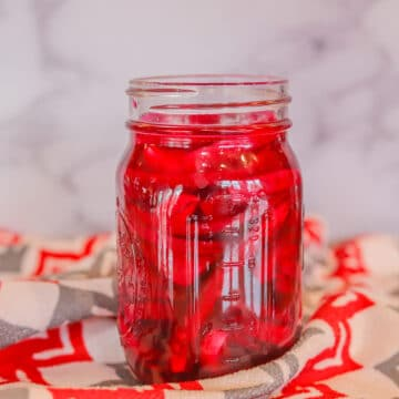 pickled pink onions in a jar