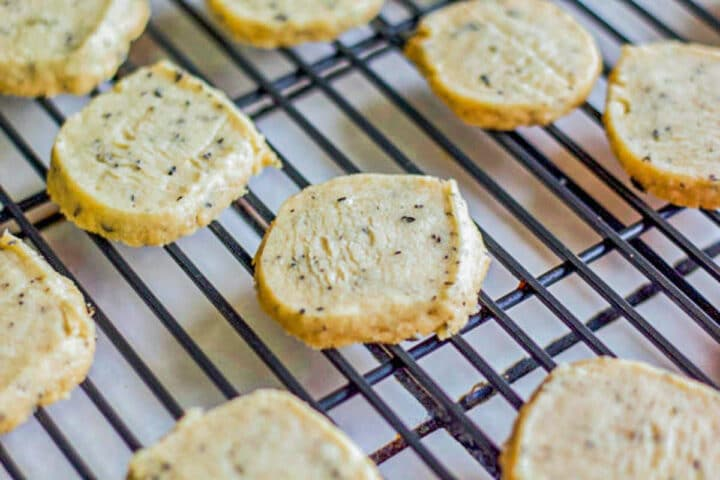 baked unbaked vegan shortbread cookies on a cooling rack