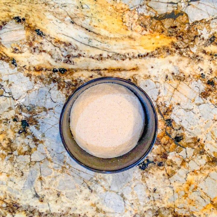 foamy yeast water in a black bowl