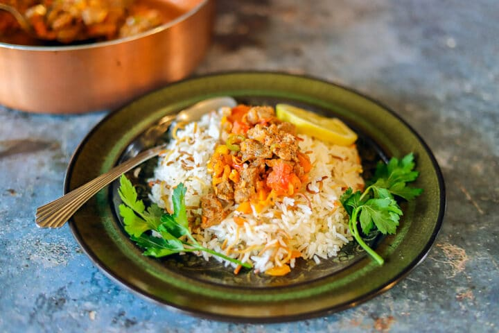 chilifry on rice with a pan in the background