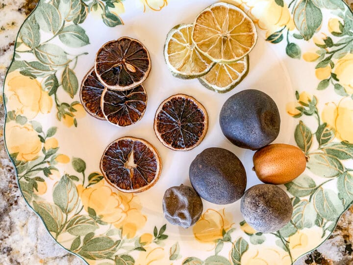 a plate full of dried lime slices and dried limes