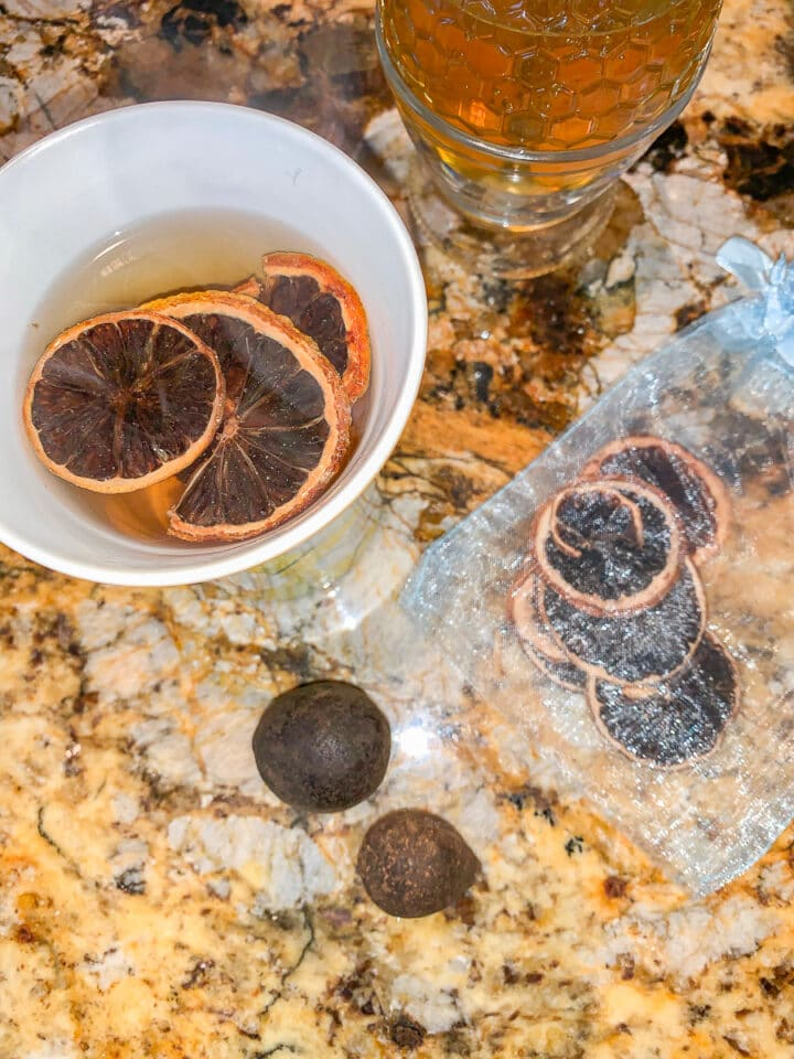 Noomi basra chai with dried limes around it