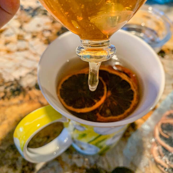 honey being added to lime tea