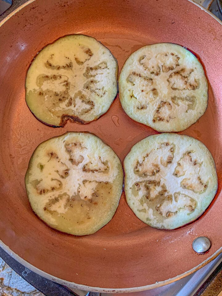 4 slices of eggplant in a pan
