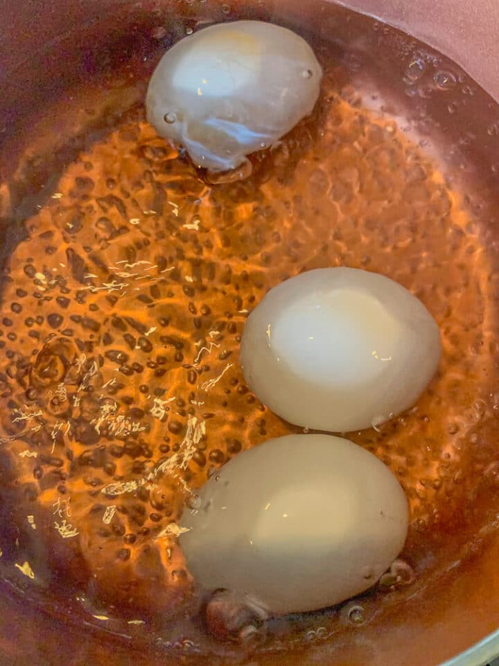 eggs boiling in a pot