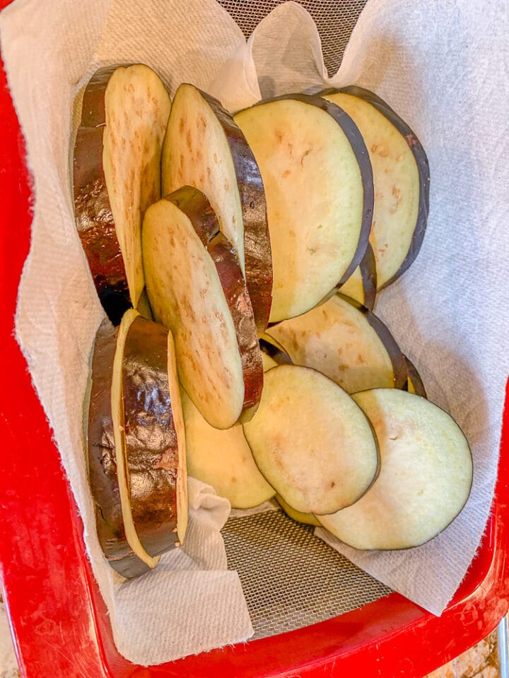eggplant sliced in a colander