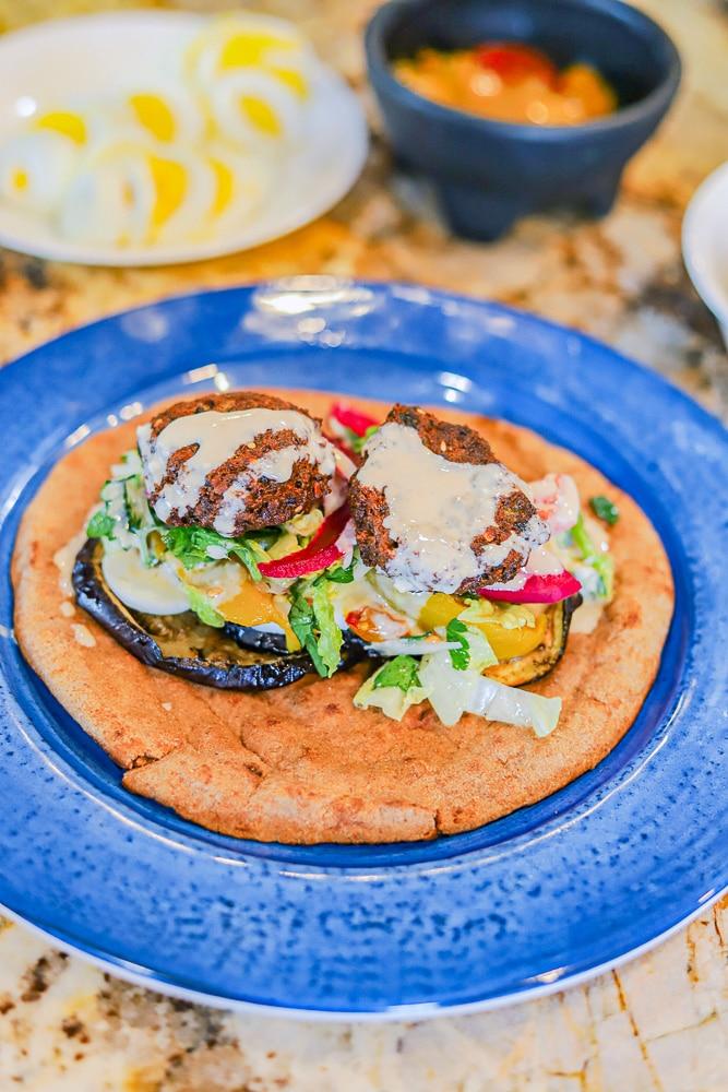 Sabich Sandwich on a blue plate