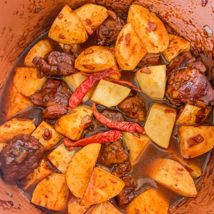 a pot full of lamb chunks and chopped turnips