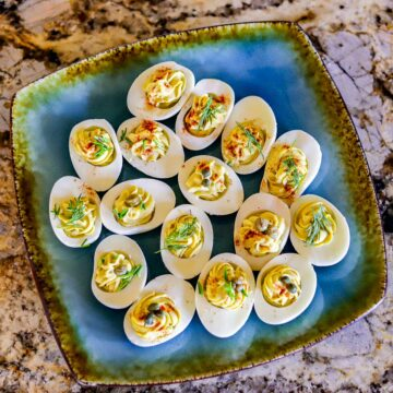 healthy deviled eggs on a blue plate