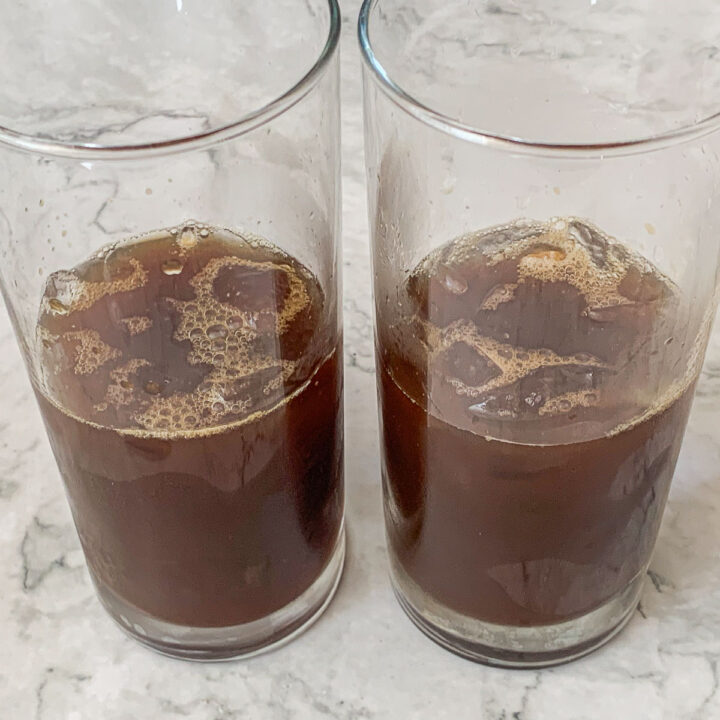 two glasses with iced coffee iced latte