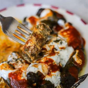 iraqi dolma recipe with sauce over it