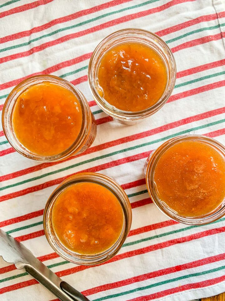peach preserves recipe being jarred