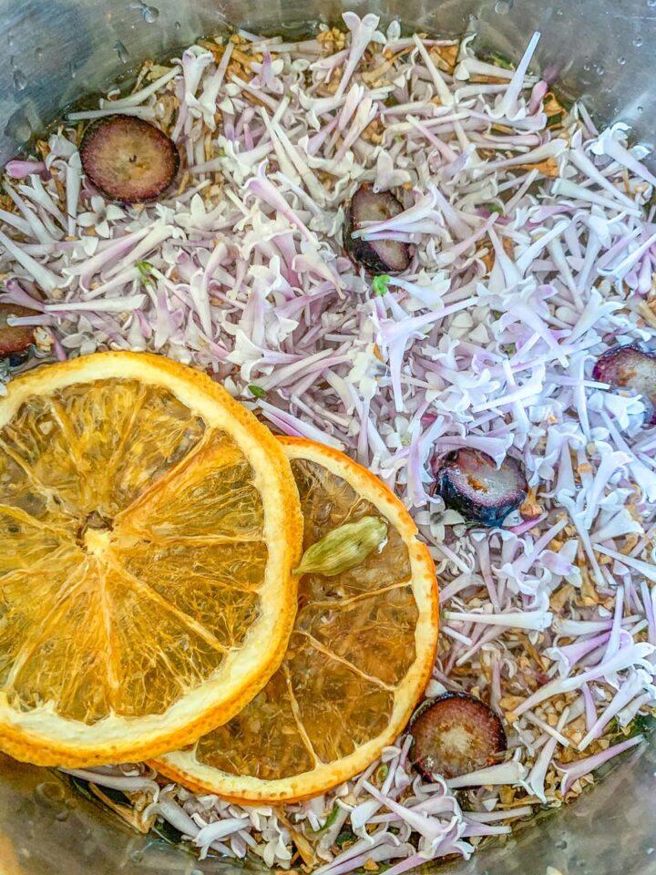 lilacs, orange slices in a pot