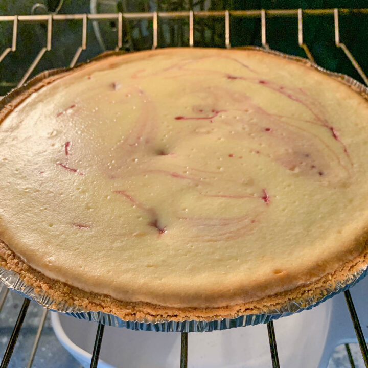 baked mulberry cheesecake in the oven