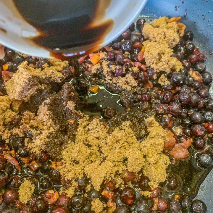 pouring vinegar over huckleberry mixture