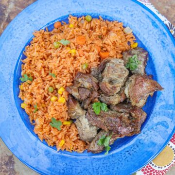carnitas and Spanish rice on a blue plate