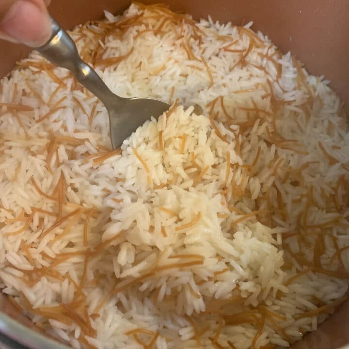 vermicelli rice being spooned out of the pot