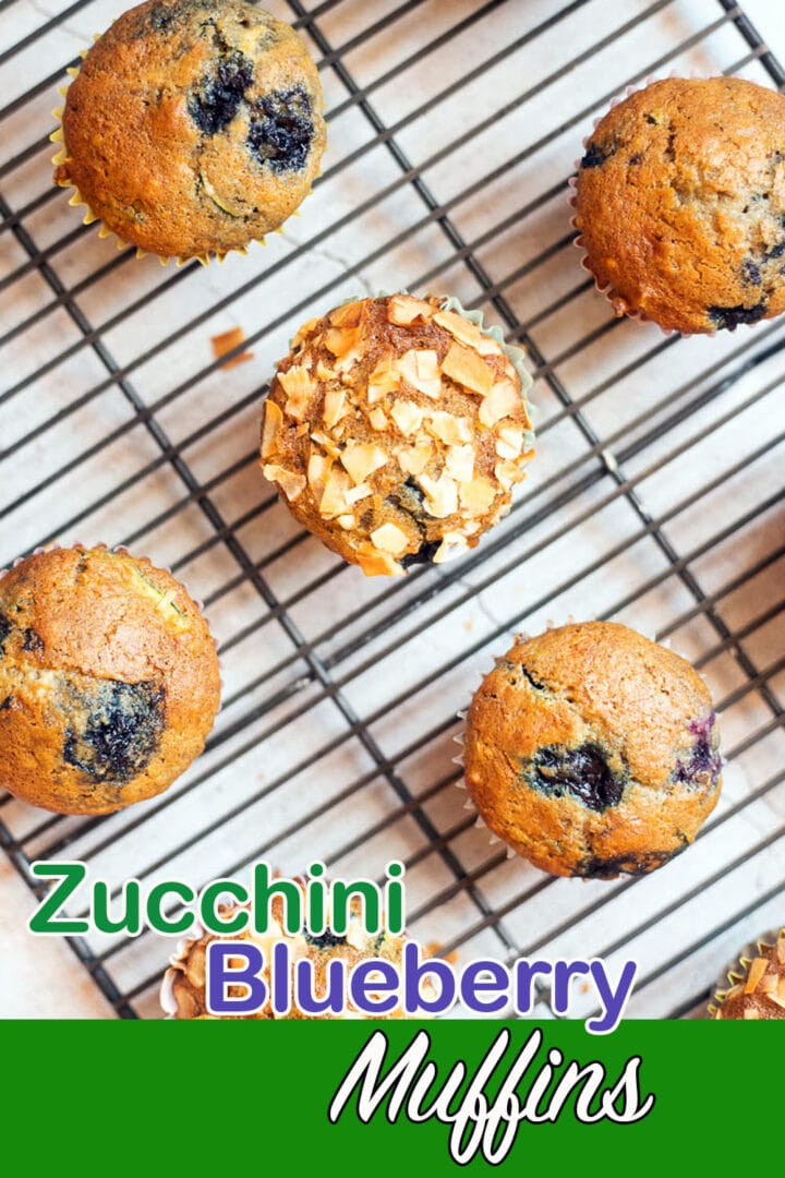 zucchini blueberry muffins on a cooling rack pin