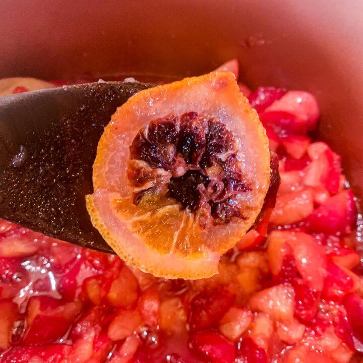 removing orange slices from crab apple jam