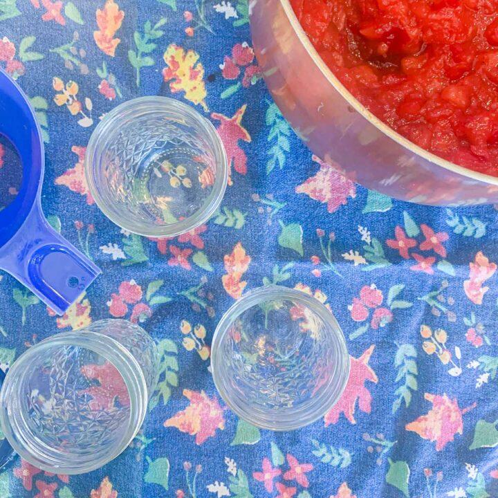 empty mason jars with a pot of jam