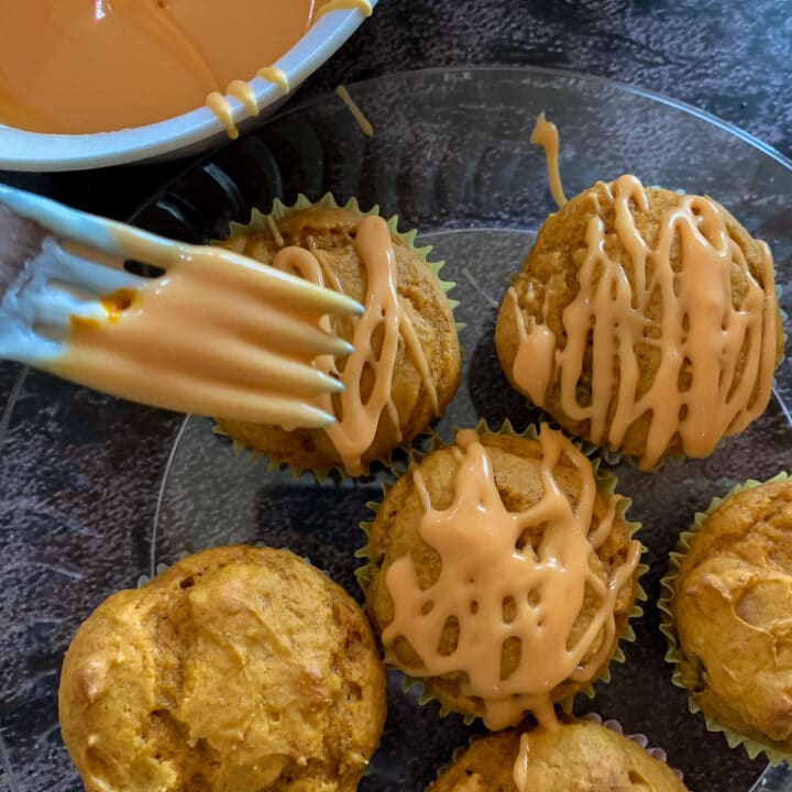 drizzling thinned out frosting over cake mix pumpkin muffins